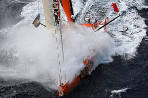 IMOCA 60 'PRB' skippered by Vincent Riou engulfed by wave ahead of the Vendee Globe, Ile des Gl�nans, France, September 2012. All non-editiorial uses must be cleared individually.  -  Benoit Stichelbaut