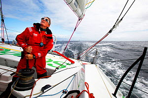 Skipper Samantha Davies trimming on board IMOCA 60 'Saveol' ahead of the Vendee Globe, Port la Foret, France, September 2012. All non-editiorial uses must be cleared individually. - Benoit Stichelbaut