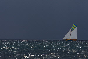 'Victory' beneath a stormy sky during the Cannes Royal Regatta as part of the Panerai Classic Yacht Challenge, Italy, September 2012. For editorial use only. - Sea & See