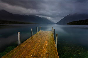 Lake Rotoiti and jetty in moody evening light, rain clouds sweeping over the surrounding moutains. Looking south, towards the Travers River Valley, Nelson Lakes National Park, Saint Arnaud, Tasman Reg... - Andy Trowbridge