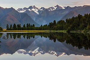 Late evening light on the Souttern Alps being perfectly relected in the calm waters of Lake Matheson. New Zealand's highest mountain, Mount Cook or Aoraki (3754m) is on the right, and Mount Tasman (34... - Andy Trowbridge