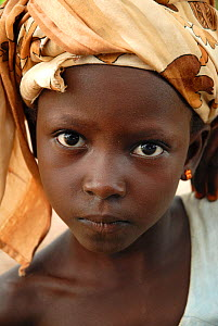 Portrait of a young girl. Bassari country, east  Senegal. This area became a UNESCO World Heritage site in 2012, for cultural landscape and traditions kept by the the Bassari, Fula and Bedik peoples....  -  Enrique Lopez-Tapia