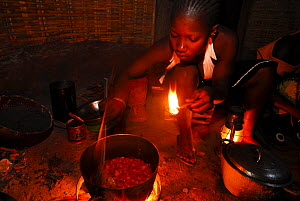 Cooking in a cabin without electricity in a small village, Bassari country, east Senegal. This area became a UNESCO World Heritage site in 2012, for cultural landscape and traditions kept by the the B... - Enrique Lopez-Tapia