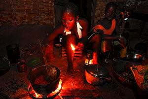 Cooking in a cabin without electricity in a small village,   Bassari country, east  Senegal. The Bassari, Fula and Bedik people keep alive their ancient traditions and customs, and UNESCO declared a W...  -  Enrique Lopez-Tapia