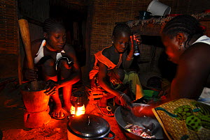 Cooking in a cabin without electricity in a small village,   Bassari country, east Senegal. The Bassari, Fula and Bedik people keep alive their ancient traditions and customs, and UNESCO declared a Wo... - Enrique Lopez-Tapia