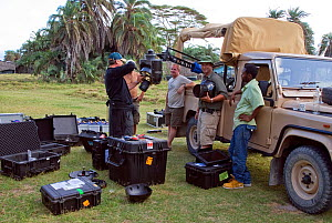 Simon Werry (watched by cameramen Mike Cuthbert and Martyn Colbeck) rigging Cineflex yogicam in back of vehicle. Amboseli, Kenya. December 2007. Taken on location for BBC tv series 'Life'  -  Martha Holmes