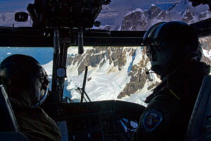Interior of Royal Navy helicopter showing pilots. Antarctic Peninsula. February 2008. Taken on location for BBC tv series 'Life'  -  Martha Holmes