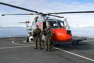 Aerial cameraman David Baillie and producer Martha Holmes on flight deck of HMS Endurance, standing by helicopter mounted with Gyron (stabilised aerial camera). February 20008. Taken on location for B... - Martha Holmes