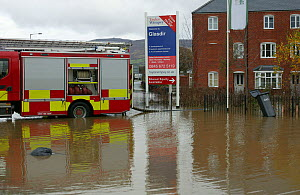 Fire engine working to drain flooding of newly built housing in Glasdir estate, with houses for sale, Ruthin, Vale of Clwyd, Denbighshire, Wales, UK.  This is an area at risk of flooding and therefore...  -  David Woodfall