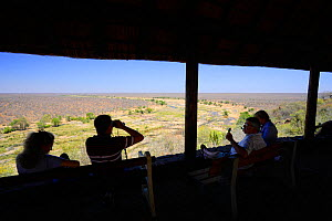 Tourists looking from the Olifants Camo lookout hide, Kruger National Park, Transvaal, South Africa, September 2008.  -  Oriol Alamany
