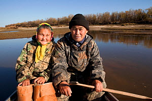 Selkup couple, Andrey Kargochev and his wife, Ludmilla, about to go berry picking by boat in the autumn, Tolka, Krasnoselkup, Yamal, Western Siberia, Russia - Bryan and Cherry Alexander
