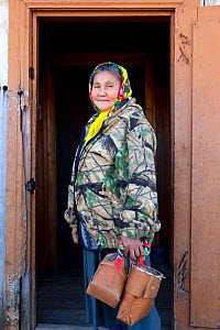 Ludmilla Kargocheva, a Selkup woman, returns to her home after berry picking in the autumn, Tolka, Krasnoselkup, Yamal, Western Siberia, Russia - Bryan and Cherry Alexander