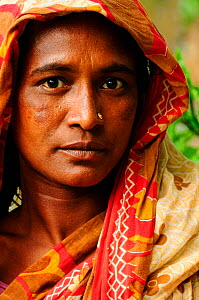 Portrait of a woman from the small village of Gagramari in the Sundarbans National Park, UNESCO World Heritage Site site, Bangladesh, June 2012  -  Enrique Lopez-Tapia