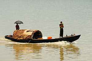 People in  boat on a river in the Sundarbans National Park, the largest mangrove swamp in the world. Bangladesh. UNESCO World Heritage Site. June 2012.  -  Enrique Lopez-Tapia