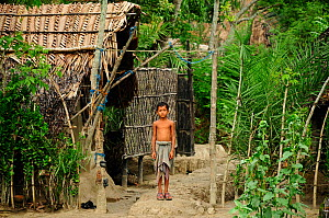 Boy outside house,  Sundarbans National Park, the largest mangrove swamp in the world. Bangladesh. UNESCO World Heritage Site. June 2012. - Enrique Lopez-Tapia