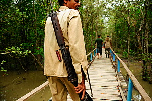 Armed guard in the Sundarbans national park. Tourist groups are accompanied by an armed guard as this area has the largest population of tigers in Asia, and also the highest number of tiger attacks on... - Enrique Lopez-Tapia