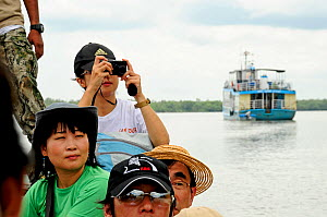 Japanese tourists taking photographs in Sundarbans National Park, the largest mangrove swamp in the world. Bangladesh UNESCO World Heritage Site. June 2012. - Enrique Lopez-Tapia