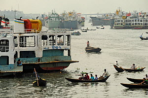 A mixture of working boats on the Sadarghat water front, Dhaka, Bangladesh, June 2012. - Enrique Lopez-Tapia