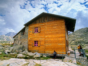Colomina mountain hut, with man playing the accordian, Aiguestortes i Estany de Sant Maurici National Park, Vall Fosca, Pyrenees Pallars Jussa�, Catalonia, Spain - Oriol Alamany
