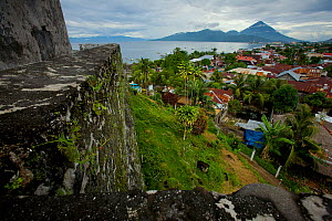 Fort Tolukko, restored Portugese fort dating from 1512 overlooking Ternate harbour. Ternate is the ancient capitol of the spice trade, Maluku Islands, Indonesia 2008  -  Tim Laman/Nat Geo Image Collection