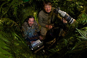 Photographer Tim Laman and Ornithologist Edwin Scholes in a blind to capture the Wahnes's Parotia, Papua New Guinea 2011  -  Tim Laman/Nat Geo Image Collection