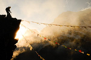 Climber on Kala Pattar peak (5545m) with Buddhist prayer flags at sunset. Sagarmatha National Park UNESCO World Heritage Site, Khumbu/Everest Region, Nepal, Himalaya. October 2011. Winner of Mountain...  -  Enrique Lopez-Tapia
