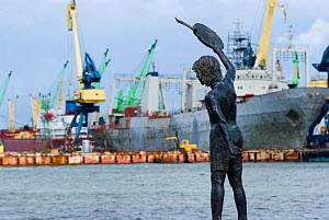 Statue of young boy waving the ships good voyage on the dockside in the industrial harbour of Klaipeda, Lithuania, August 2007.  -  UNCATALOGUED
