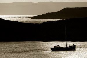 Small ship anchored in Loch Sunart on the Ardnamurchan point, north-west Scotland, March 2008.  -  UNCATALOGUED