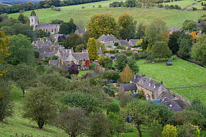 View of the village of Naunton, showing the village church of St. Andrew's, Cotswolds, Gloucestershire, October 2012  -  Gary K. Smith