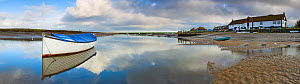 Boat and reflections in still water at Burnham Overy Staithe, Norfolk, England, November - Gary K. Smith