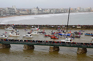 IMOCA 60 'Macif' skippered by Francois Gabart finishing first in the Vendee Globe in a record time of 78 days 2 hours 16 minutes and 40 seconds. Les Sables d'Olonne, France, 27th January 2013. All non... - Benoit Stichelbaut