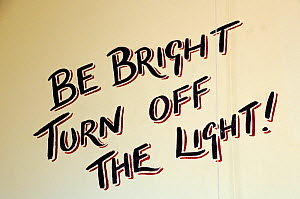 Be Bright Turn Off the Light, written on the lavatory wall at Hackney City Farm, London, England UK  -  Pat  Tuson