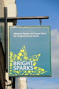 Bright Sparks sign, Islington Repair and Reuse Shop for small electrical items, London UK  -  Pat  Tuson