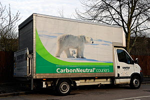 Delivery van for Carbon Neutral Couriers on side street in Highbury, London Borough of Islington, UK. With photo of polar bear and cub  -  Pat  Tuson