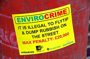 Envirocrime label stuck onto a cylinder with inflammable contents dumped in street London Borough of Islington, UK - Pat  Tuson