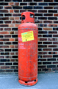 Envirocrime label stuck onto a cylinder with inflammable contents dumped in street, London Borough of Islington, UK  -  Pat  Tuson