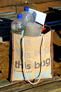 Reusable cotton bag with plastic bottles for use as garden cloches within, London UK  -  Pat  Tuson
