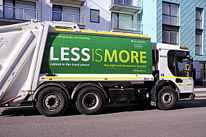 Rubbish collection vehicle with Less is More printed on the side advertising recycling, London Borough of Islington, UK  -  Pat  Tuson