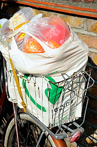 Shopping in reusable cotton bag in wire backet on bicycle, London, UK  -  Pat  Tuson