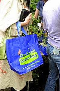 The Small Green Bag, reusable shopping bag from Tesco held by woman in queue at plant sale, London UK  -  Pat  Tuson