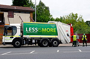 Waste Truck with recycling slogan on the side, working at the rear Highbury, London Borough of Islington, UK  -  Pat  Tuson