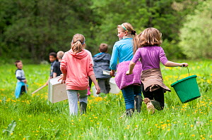 School children carrying equipment to release salmon fry in the River Haddeo and to do invertebrate kick samples with Westcountry Rivers Trust (WRT) warden. Bury, Exmoor National Park, Somerset, UK. M...  -  Ross Hoddinott / 2020VISION