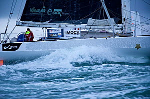 IMOCA 60 'Votre Nom Autour du Monde' skippered by Bertrand de Broc finishing 9th in the Vendee Globe in choppy conditions, Les Sables d'Olonne, France, 10th February 2013. All non-editorial uses must... - Benoit Stichelbaut