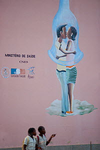 HIV / AIDS awareness campaign, graphics painted onto side of building on the edge of the market square, Sao Tome, Democratic Republic of Sao Tome and Principe, Gulf of Guinea 2009 - Jabruson