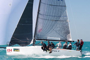 Boat under spinnaker during a race at Key West Race Week, Florida, USA, January 2013. All non-editorial uses must be cleared individually. - Ingrid Abery