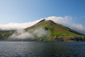 View of active volcano at Chirpoy Island, Kurils, Russian Far East. Chirpoy (meaning small bird) is the collective name usually given to the twin volcanic islands of Chirpoy and Brat Chirpoev (Russian... - Sue Flood