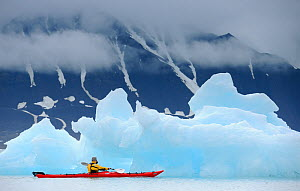 Kayaking past icebergs in Svalbard, Norway, July 2011. Model released. - Staffan Widstrand