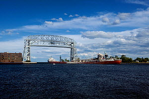 Ore boat leaving the Duluth Harbor Basin, in Lake Superior under the Aerial Bridge, Duluth, Minnesota, USA, August 2011  -  Kirkendall-Spring