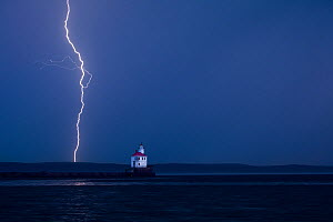 Lightning storm during sunrise at Wisconsin Point Lighthouse on Lake Superior near the town of Superior. Wisconsin, USA, August 2011  -  Kirkendall-Spring