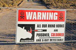 Warning sign explaining that rhino horns within reserve are poisoned and coloured. Private game reserve, near Ceres, Karoo, South Africa, November  -  Tony Phelps